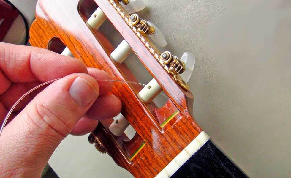 jla music how to change strings on a nylon string guitar and oil the fingerboard. Black Bedroom Furniture Sets. Home Design Ideas
